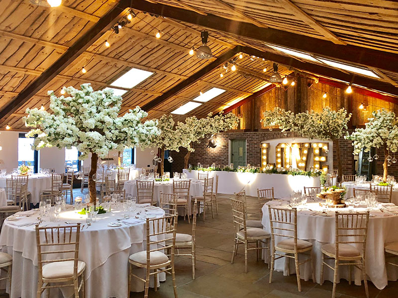 Rustic--full-venue-with-LED-letters-and-blossoms