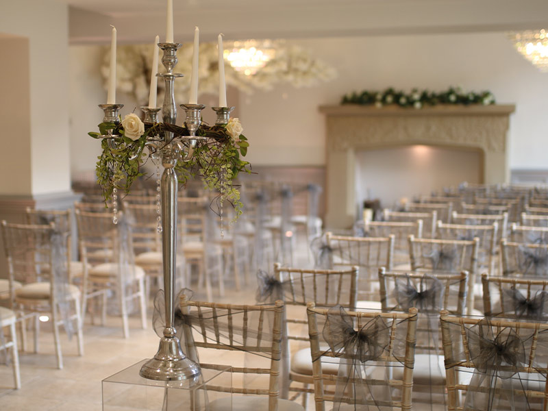 silver-candelabra-with-chair-decor